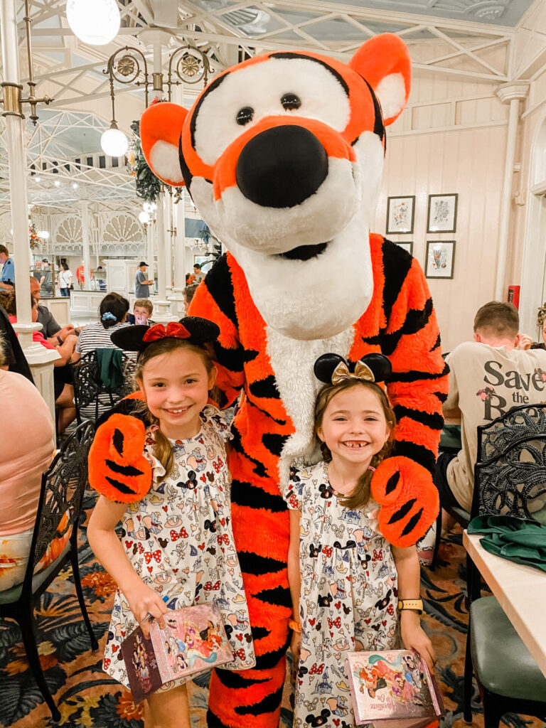 Disney Creators Celebration by popular Nashville lifestyle blog, Hello Happiness: image of two girls standing with Tigger.